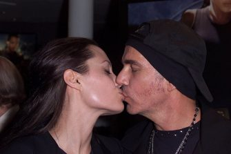 LONDON - JULY 4: Actress Angelina Jolie kisses husband, actor Billy Bob Thornton, at the UK premiere of her new film 'Lara Croft: Tomb Raider' at the Empire Cinema on July 4, 2001 in Leicester Square, London, England. The film is based on the hugely successful computer game action hero, Lara Croft. (Photo by Dave Hogan/Getty Images)