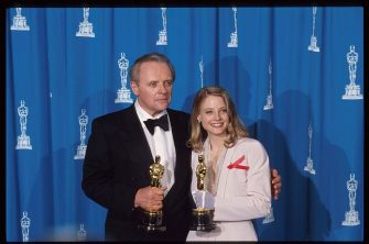 """120528 13: Best Actor recipient Anthony Hopkins stands with Best Actress recipient Jodie Foster at the 64th annual Academy Awards March 30, 1992 in Los Angeles, CA. The Academy of Motion Picture Arts and Sciences awarded five Oscars to the film """"Silence of the Lambs."""" (Photo by John Barr/Liaison)"""