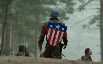 Chris Evans (standing, with shield) plays Steve Rogers, Bruno Ricci (center left) plays Dernier, and J.J. Feild (wearing red beret) plays Falsworth in Marvel Studios? CAPTAIN AMERICA: THE FIRST AVENGER. ?