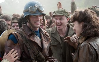 Foreground left to right: Chris Evans plays Steve Rogers and Hayley Atwell plays Peggy Carter in Marvel Studios? CAPTAIN AMERICA: THE FIRST AVENGER. ??