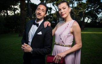 CAP D'ANTIBES, FRANCE - MAY 17:  Adrien Brody and Milla Jovovich pose for portraits at the amfAR Gala Cannes 2018 cocktail at Hotel du Cap-Eden-Roc on May 17, 2018 in Cap d'Antibes, France.  (Photo by Pascal Le Segretain/amfAR/WireImage for amfAR)