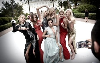 CANNES, FRANCE - MAY 21:  (L-R) Natasha Poly, Barbara Palvin, Soo-Joo Park, Eva Longoria, Karlie Kloss, Doutzen Kroes and Lara Stone attend amfAR's 22nd Cinema Against AIDS Gala, Presented By Bold Films And Harry Winston at Hotel du Cap-Eden-Roc on May 21, 2015 in Cannes, France. (Photo by Gareth Cattermole/Getty Images for L'Oreal)