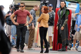 """NEW YORK, NY - SEPTEMBER 02:  (L to R) Actors Jeremy Renner, Scarlett Johansson, and Tom Hiddleston film a scene at """"The Avengers"""" movie set in Central Park on September 2, 2011 in New York City.  (Photo by Ray Tamarra/Getty Images)"""