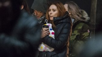 Elizabeth Olsen feels the cold as she films scenes for upcoming movie 'Avengers: Infinity War' on the Royal Mile in Edinburgh, Scotland  Featuring: Elizabeth Olsen Where: Edinburgh, United Kingdom When: 04 Apr 2017 Credit: Euan Cherry/WENN.com