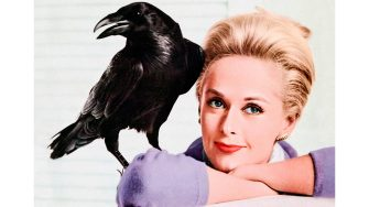 Tippi Hedren with a crow, publicity photograph for the release of The Birds (1963) directed by Alfred Hitchcock; an adaptation of Daphne Du Maurierâ  s horror story about birds attacking humans.