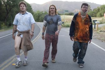 """Dale Denton (Seth Rogen, left), Saul Silver (James Franco, center), and Red (Danny McBride, right) run for their lives in """"Pineapple Express."""" (2008) Photo by: Columbia Pictures"""