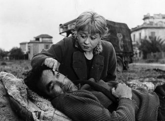 1954:  Italian actor Giulietta Masina (1920 - 1994) raising Mexican-born actor Anthony Quinn's  (1915 - 2001) eyebrow with her finger as Quinn iies on the ground, in a still from director Federico Fellini's film, 'La Strada'.  (Photo by Hulton Archive/Getty Images)
