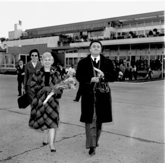 Federico Fellini is with Giulietta Masina, she is about to leave for Germany. (Photo by Archivio Cicconi/Getty Images)