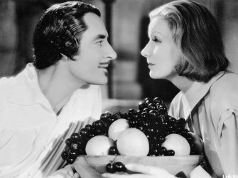 (Original Caption) Garbo And Gilbert-Greta and H=John Gilbert blistering the screen in a love scene from Queen Christina which will be inclined on ABC-TV's, MGM Parade, Wednesday, April 4, 8:30 p.m., EST, when the first episode of a two part series on The Greatness of Garbo will be presented. The story will be concluded on MGM Parade, April 11.