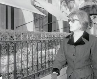 (Original Caption) Wearing her familiar dark glasses, a grim expression and clothes not in keeping with today's high fashion trends, actress Greta Garbo leaves the Christian Dior Salon after a shopping trip here, Oct.1st. the ever-mysterious Swedish star is being escorted by George Schlee.