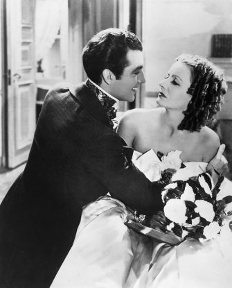(Original Caption) Washington: Greta Garbo, with Robert Taylor, in a scene from, Camille, made in 1937 and directed by George Cukor.