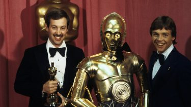 THE 50TH ANNUAL ACADEMY AWARDS - Show Coverage - Shoot Date: April 3, 1978. (Photo by Walt Disney Television via Getty Images Photo Archives/Walt Disney Television via Getty Images)BENJAMIN BURTT JR.;C3PO;MARK HAMILL