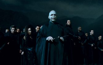 """HELENA BONHAM CARTER as Bellatrix Lestrange (left of center) and RALPH FIENNES as Lord Voldemort (center) flanked by Death Eaters in Warner Bros. Pictures' fantasy adventure """"HARRY POTTER AND THE DEATHLY HALLOWS – PART 2,"""" a Warner Bros. Pictures release."""