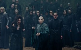 """(L-r) JASON ISAACS as Lucius Malfoy, HELENA BONHAM CARTER as Bellatrix Lestrange and RALPH FIENNES as Lord Voldemort in Warner Bros. Pictures' fantasy adventure """"HARRY POTTER AND THE DEATHLY HALLOWS – PART 2,"""" a Warner Bros. Pictures release."""