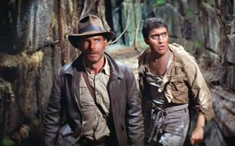 """LOS ANGELES - JUNE 12: The movie: Indiana Jones and the Raiders of the Lost Ark , (aka: """"Raiders of the Lost Ark""""), directed by Steven Spielberg.  Seen here from left, Harrison Ford as Indiana Jones and Alfred Molina as Satipo.  Initial theatrical release June 12, 1981.  Screen capture. A Paramount Picture. (Photo by CBS via Getty Images)"""