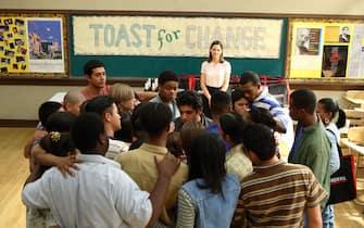 (Standing, Center)  Hilary Swank as Erin Gruwell.