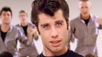 """LOS ANGELES - JUNE 16: The movie """"Grease"""", directed by Randal Kleiser. Seen here, the musical number,  """"Greased Lightning,"""" led by John Travolta (front and center) as Danny Zuko.Initial theatrical release of the film, June 16, 1978.Screen capture. Paramount Pictures. (Photo by CBS via Getty Images)"""