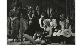 Italian actor Marcello Mastroianni watching a woman assisted during a party in a seaside villa in the film La dolce vita. Fregene (Fiumicino), 1959. (Photo by Mondadori via Getty Images)
