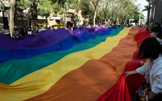 Activists seen carrying a big rainbow flag during the 2020 Taiwan pride parade. More than 130,000 marched in Taipei on Saturday for one of the world's largest LGBT pride parades, in celebration of the island's 18th annual pride parade and its successful handling of the COVID-19 pandemic. (Photo by Hsiuwen Liu / SOPA Images/Sipa USA)
