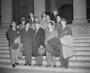 (Original Caption) Hollywoodites pleaded not guilty today to charges of contempt of Congress arising from their refusal to state under oath whether they are, or ever have been Communists. Shown as they arrived at the District Building for arraignment in U.S. District Court are: Left to right, 1st and 2nd rows, inclusive, Director Producer Herbert Biberman; Writer Dalton Trumbo; Attorney Martin Popper; Writer John Lawson; Attorney Robert W. Kenny; Writers Alva Bessie; Albert Malz, Samuel Ornitz, and Lester Cole. In the rear, left to right, are: Writer Ring Lardner, Jr.; Director Edward Dmytryk, and Producer Adrian Scott.