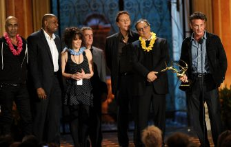"""CULVER CITY, CA - JUNE 04:  (L-R) Actor Taylor Negron, actor Forest Whitaker, director Amy Heckerling, actor Brian Backer, actor Judge Reinhold, actor Robert Romanus and actor Sean Penn accept the Guy Movie Hall of Fame award for """"Fast Times on Ridgemont High"""" onstage during Spike TV's 5th annual 2011 """"Guys Choice"""" Awards at Sony Pictures Studios on June 4, 2011 in Culver City, California.  (Photo by Kevin Winter/Getty Images)"""