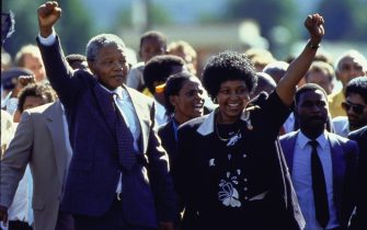ANC ldr. Nelson Mandela and wife Winnie raising fists upon his release from Victor Verster prison after 27 yrs.    (Photo by Allan Tannenbaum/Getty Images)