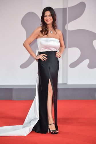 """VENICE, ITALY - SEPTEMBER 09: Manuela Arcuri attends the red carpet of the movie """"Les Choses Humaines"""" during the 78th Venice International Film Festival on September 09, 2021 in Venice, Italy. (Photo by Stephane Cardinale - Corbis/Corbis via Getty Images)"""