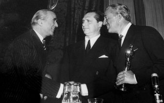 This old picture, which shows Vittorio De Sica (R) who receiving the ''Oscar'' for the movie ''Bicycle Thieves'' (1948) is exposed at Ara Pacis Museeum, in Rome, 07 February 2013. The exhibition will run until 28 April 2013.    ANSA/CLAUDIO PERI