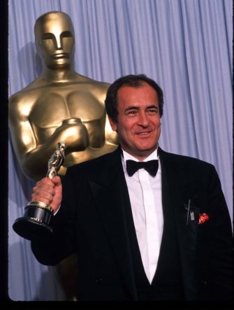 "049944 26: Director Bernardo Bertolucci holds his Best Director Oscar for ""The Last Emperor"" at the Academy Awards April 11, 1988 in Los Angeles, CA. The Academy Awards are prizes given out annually in Hollywood for excellence in film performance and production. (Photo by John Barr/Liaison)"