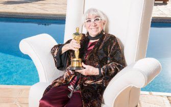 LOS ANGELES, CALIFORNIA - OCTOBER 26: Lina Wertmuller poses with the Oscar of Dino de Laurentiis at the Honorary Oscar Lina Wertmuller's Celebration Lunch Hosted By Martha De Laurentiis With Genoma Films And Sardinia Film Commission on October 26, 2019 in Los Angeles, California. (Photo by Daniele Venturelli/Daniele Venturelli/WireImage )