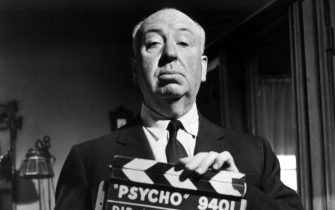 British film director Alfred Hitchcock (1899 - 1980) holding up a clapperboard on the set of his film, 'Psycho', USA, 29th January 1960. (Photo by Hulton Archive/Getty Images)