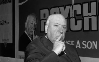 (Original Caption) Suspense director Alfred Hitchcoack opens in a mock recreation from a scene in his latest film Psycho which he ia presenting her in Paris.