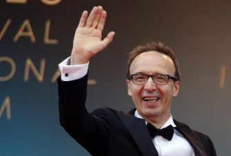 epa06733290 Roberto Benigni arrives for the screening of 'Happy As Lazzaro (Lazzaro Felice)' during the 71st annual Cannes Film Festival, in Cannes, France, 13 May 2018. The movie is presented in the Official Competition of the festival which runs from 08 to 19 May.  EPA/FRANCK ROBICHON