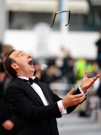 epa06733076 Roberto Benigni arrives for the screening of 'Happy As Lazzaro (Lazzaro Felice)' during the 71st annual Cannes Film Festival, in Cannes, France, 13 May 2018. The movie is presented in the Official Competition of the festival which runs from 08 to 19 May.  EPA/CLEMENS BILAN