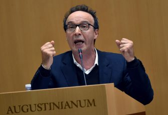 Italian actor and director Roberto Benigni gestures during the presentation of the book ' The name of God is Mercy' (Il nome di Dio e' Misericordia), Rome, Italy, 12 January 2016. Pope Francis' first book as pontiff is a 100-page conversation with Italian journalist Andrea Tornielli.   ANSA/ETTORE FERRARI