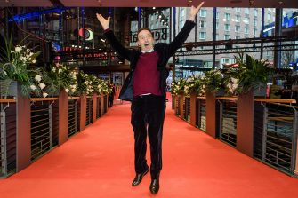 epa08241344 Actor Roberto Benigni jumps in front of photographers as he arrives for the premiere of 'Pinocchio' during the 70th annual Berlin International Film Festival (Berlinale), in Berlin, Germany, 23 February 2020. The movie is presented in the Berlinale Special section at the Berlinale that runs from 20 February to 01 March 2020.  EPA/CLEMENS BILAN