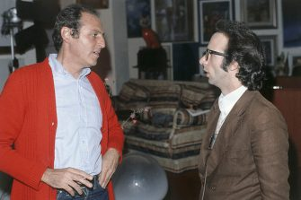 Italian actor and director Roberto Benigni looking into the eyes Italian showman Renzo Arbore while he waits to take part in the TV variety show L'Altra Domenica. Italy, 1978. (Photo by Rino Petrosino/Mondadori via Getty Images)