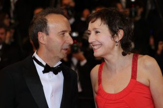 """TOPSHOT - Italian actress and producer Nicoletta Braschi and her husband, Italian actor and director Roberto Benigni arrive on May 16, 2018 for the screening of the film """"Dogman"""" at the 71st edition of the Cannes Film Festival in Cannes, southern France. (Photo by Valery HACHE / AFP)        (Photo credit should read VALERY HACHE/AFP via Getty Images)"""