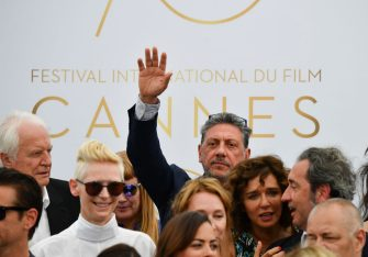 Italian actor Sergio Castellitto (Rear C) waves as he poses with (From L) French actor Andre Dussollier, British actress Tilda Swinton, Italian actress Valeria Golino and Italian director and member of the Feature Film jury Paolo Sorrentino on May 23, 2017 during a photocall for the '70th Anniversary' of the Cannes Film Festival in Cannes, southern France.  / AFP PHOTO / Alberto PIZZOLI        (Photo credit should read ALBERTO PIZZOLI/AFP via Getty Images)