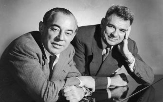 circa 1945:  Studio portrait of American musical team, composer Richard Rodgers (L), (1902 - 1979), and songwriter Oscar Hammerstein (1895 - 1960), leaning over a piano.  (Photo by Hulton Archive/Getty Images)