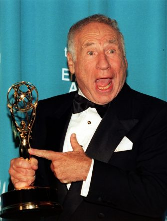 "LOS ANGELES, UNITED STATES:  Comedian Mel Brooks points to his Emmy awardat the 50th Annual Primetime Emmy Awards 13 Sept at the Shrine Auditorium in Los Angeles.   Brooks won his Emmy for Outstanding Guest Actor in a Comedy Series for his role as Uncle Phil in ""Mad About You"". .   AFP PHOTO  Kim KULISH/mn (Photo credit should read KIM KULISH/AFP via Getty Images)"