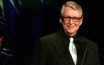 "BEVERLY HILLS, CA - FEBRUARY 19:  Director Mike Nichols presents the ""Lacoste Career Achievment award for Film"" onstage at the 7th Annual Costume Designers Guild Awards at the Beverly Hilton Hotel on February 19, 2005 in Beverly Hills, California.  (Photo by Frazer Harrison/Getty Images)"