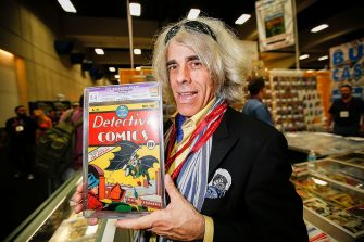 SAN DIEGO, CA - JULY 26:  Michael Carbonaro of D&A Cardworld poses with Detective Comics #27 at Comic-Con International at San Diego Convention Center on July 26, 2014 in San Diego, California.  The May 1939 issue marks the first appearance of the Batman character and is valued at approximately $550,000.  (Photo by Daniel Knighton/WireImage)