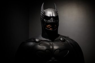LONDON, ENGLAND - FEBRUARY 22: A Batman costume from the 1995 Batman Forever film worn by Val Kilmer and designed by Rob Ringwood and Ingrid Ferrin is on display at the DC Comics Exhibition: Dawn Of Super Heroes at the O2 Arena on February 22, 2018 in London, England. The exhibition, which opens on February 23rd, features 45 original costumes, models and props used in DC Comics productions including the Batman, Wonder Woman and Superman films. (Photo by Jack Taylor/Getty Images)