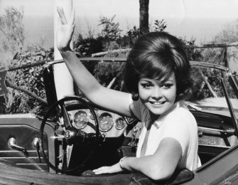 Actress Sandra Milo waving from her car in a scene from the film 'The Big Parasol', Rome, October 1965. (Photo by Keystone/Hulton Archive/Getty Images)