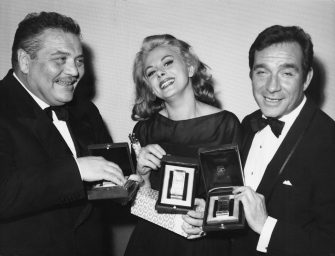 From left to right, actors Folco Lulli, Sandra Milo and Ugo Tognazzi receive Nastri d'Argento (Silver Ribbons) at the Italian National Syndicate of Film Journalists awards in Rome, Italy, 6th April 1964. Lulli and Milo received Best Supporting Actor and Actress respectively, and Tognazzi won Best Actor.  (Photo by Keystone/Hulton Archive/Getty Images)