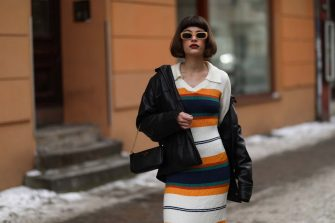 BERLIN, GERMANY - FEBRUARY 15: Lea Naumann wearing Prada black bag, Who what wear dress, vintage leather jacket and Zalando shades on February 15, 2021 in Berlin, Germany. (Photo by Jeremy Moeller/Getty Images)