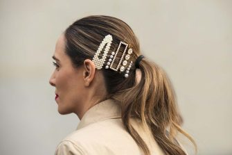 PARIS, FRANCE - MARCH 03: A guest wears pearl hair slides and clips on March 03, 2020 in Paris, France. (Photo by Kirstin Sinclair/Getty Images)