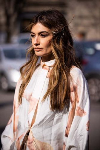 MILAN, ITALY - FEBRUARY 21: Angela Rozas Saiz, wearing a white printed shirt and gold hair clips, is seen outside Emporio Armani show, during Milan Fashion Week Fall/Winter 2020-2021 on February 21, 2020 in Milan, Italy. (Photo by Claudio Lavenia/Getty Images)
