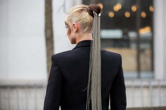PARIS, FRANCE - FEBRUARY 26: A guest is seen with hair piece, pigtail outside Mugler during Paris Fashion Week - Womenswear Fall/Winter 2020/2021 : Day Three on February 26, 2020 in Paris, France. (Photo by Christian Vierig/Getty Images)